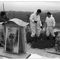 "The Missing Persons Unit of the United Nations police in Kosovo digs up bodies for identification in the ""martyr's graveyard"" near Landovice. Witnesses reported burying two men, but a woman and half of a man were found."
