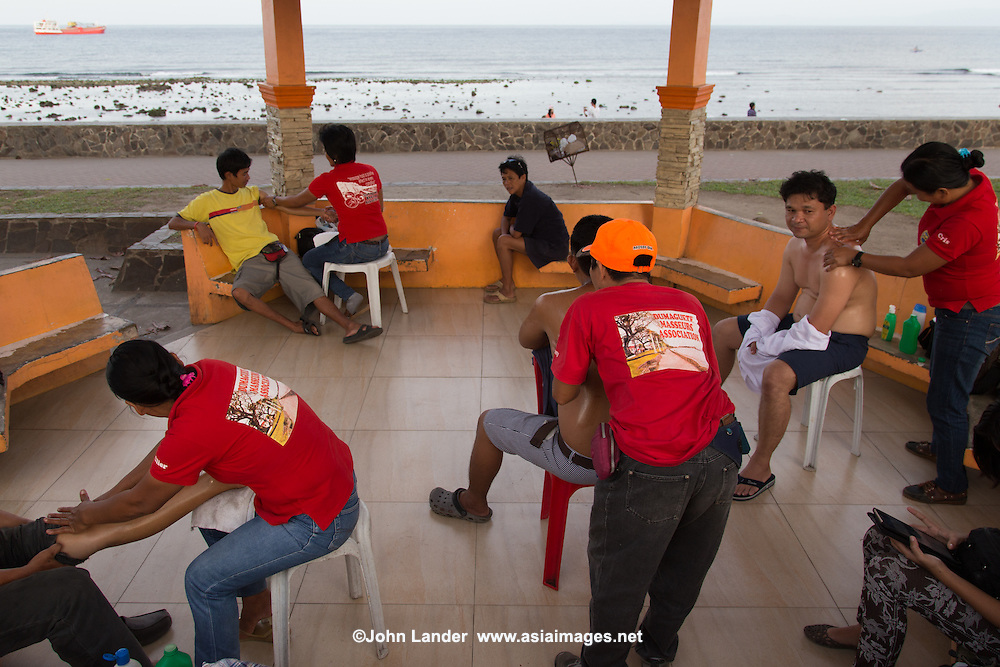 Dumaguete Community Massage - along Rizal Boulevard in Dumaguete every afternoon massages take place for a nominal fee, almost guaranteed to make you feel better no matter what ails you