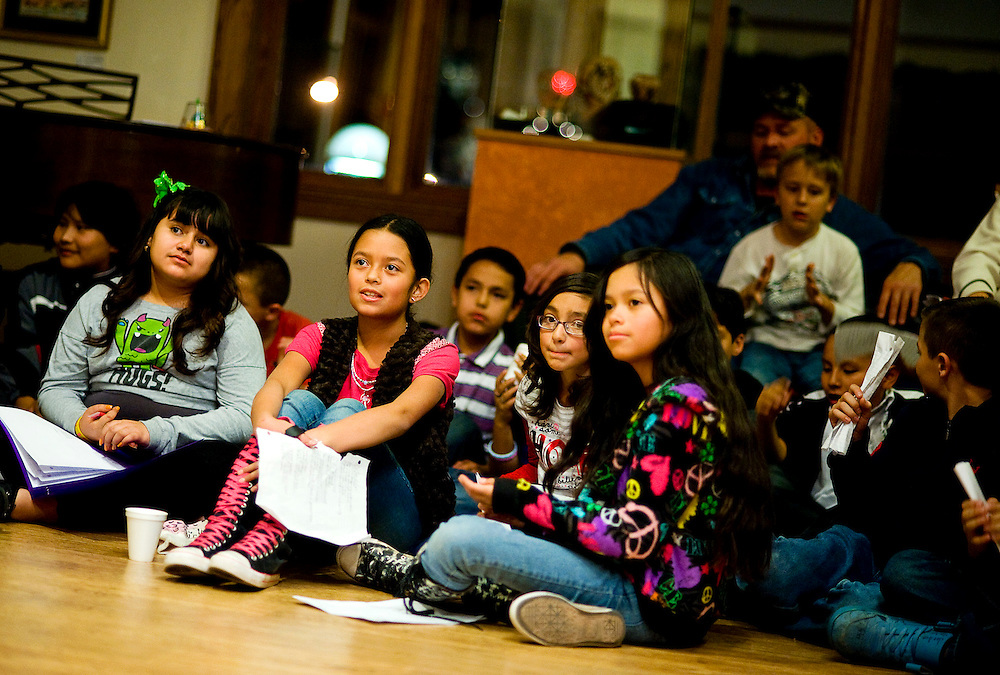 121511       Brian Leddy.Indian Hills Elementary fifth-graders listen to their classmates poetry    during Thursday's Poetry Slam at the Gallup Cultural Center. The fifth-grade class at the school spent several weeks studying forms of poetry that culminated in a Poetry Slam on Thursday for family and friends.