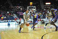 "Mississippi's Marshall Henderson (22) vs. LSU's Andre Stringer (10) at the C.M. ""Tad"" Smith Coliseum in Oxford, Miss. on Wednesday, January 15, 2013. Mississippi won 88-74 in overtime."