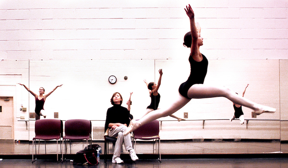 Flying through the air, Maya Basik, age 14, from Pikesville,  practices the opening act of the Nutcracker's second scene under the watchful eye of her instructor Gloria Lang, from Cockeyesville, at Towson University's Burdick Hall Sunday December 5, 2004. Close to 40 ballerinas from the Towson University Children's Dance Division, ages 7-18, vigorously prepare for participating roles in the four Nutcracker productions performed with the Moscow Ballet at the Lyric Operah House December 18 & 19, 2004.