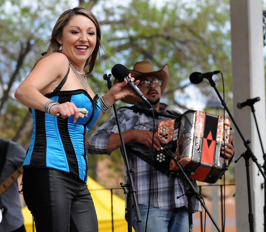 jt040817e/a sec/jim thompson/   Tanya Griego preformed during the Fiesta de Albuquerque. Saturday April 08, 2017. (Jim Thompson/Albuquerque Journal)