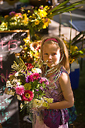 Sofia Overfelt (age 6) shops for flowers at the downtown Farmers' Market in Salt Lake City, Utah.