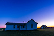 The waxing crescent Moon and Venus (above) over the old farm house at the Visitor Centre at the Old Man on His Back Prairie and Heritage Conservation Area in southwest Saskatchewan, May 20, 2015, on a very clear night. The old house was the original house lived in by the Butala family who settled the area in the 1920s.<br />