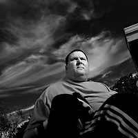 Dan Walters, a former Police Officer who was paralyzed in 2003 after being shot in the neck, sits in his wheelchair on his back porch at home in the College area of San Diego on Thursday, November 7, 2013.(Photo by Sandy Huffaker)