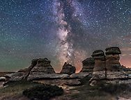 The summer Milky Way over the sandstone formations at Writing-on-Stone Provincial Park in southern Alberta, on a dark of the Moon night, July 31, 2016. The foreground is iluminated only by starlight. No artificial light painting was employed here. The Lagoon Nebula and objects in Sagittarius and Scutum are to the south here at centre.  <br /> <br /> This is a composite of a single untracked exposure for the sky, and a mean-combine average stack of 10 exposures for the ground (to smooth noise), all 30-second exposures at f/2 with the 20mm Sigma Art lens at f/2 and Nikon D750 at ISO 4000. They were shot at the end of a motion-control sequence for a time-lapse movie, shot with the Syrp Genie Mini. These frames are from the end of the sequence when the camera had ramped to a stop. Some airglow and light pollution discolour the sky.