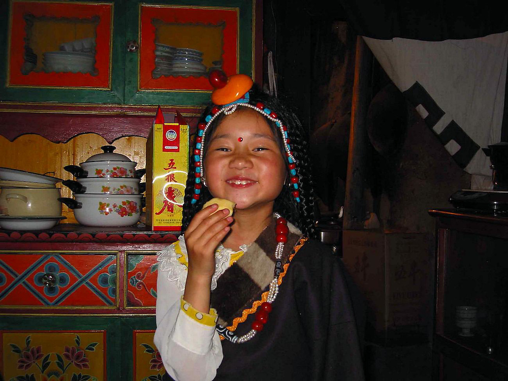 Tibet young girl in traditional costume