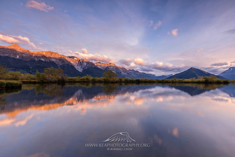 Sunrise over the Humboldt Mountains with the pyramid-shaped Mt Alfred to the right, in Glenorchy, New Zealand.