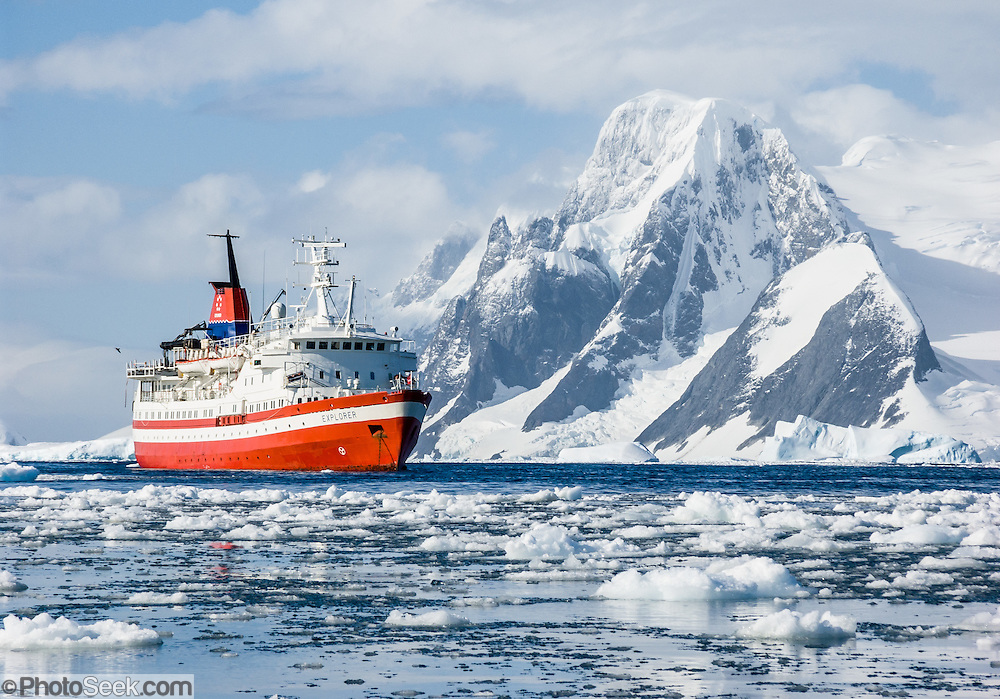 """The M/S Explorer cruises in Antarctica in February 2005. Reuters News Pictures Service published this image in stories on the M/S Explorer, which sank after hitting an iceberg in 2007 and now lies sunk 600 meters deep in the Southern Ocean. Two and a half years after our successful trip, the Explorer, owned by Canadian travel company GAP Adventures, took on water after hitting ice at 12:24 AM EST on Friday November 23, 2007. 154 passengers and crew calmly climbed into lifeboats and drifted some six hours in calm waters. A Norwegian passenger boat rescued and took them to Chile's Antarctic Eduardo Frei base, where they were fed, clothed, checked by a doctor, and later flown to Punta Arenas, Chile. The ship sank hours after the passengers and crew were safely evacuated. Published in """"Light Travel: Photography on the Go"""" by Tom Dempsey 2009, 2010."""