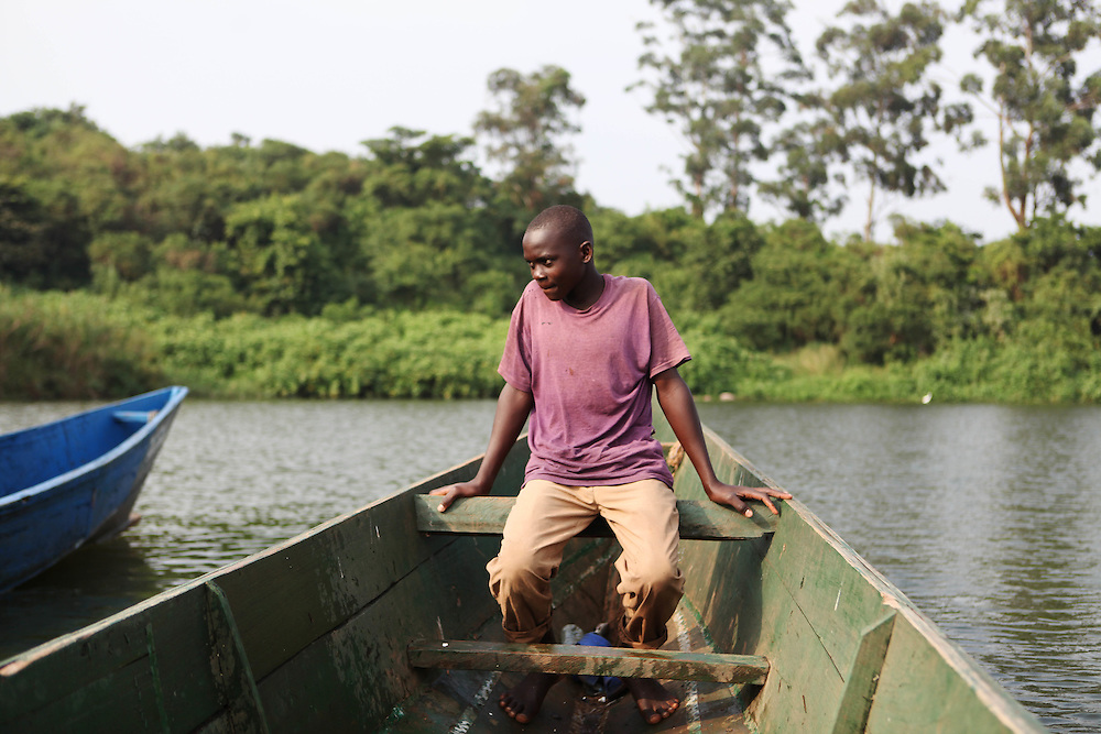 Ronald Kawesi sets out for the morning to set fishing traps in Lake Victoria. Here in Ggaba, a small town in southern Uganda that almost entirely subsists on the fishing industry, the locals have contributed to the dangerous overfishing of the lake despite strict regulations from Tanzania, Uganda, and Kenya. Fishermen continue to keep fish that are far below the required minimum weight and employ dymanite and poison.
