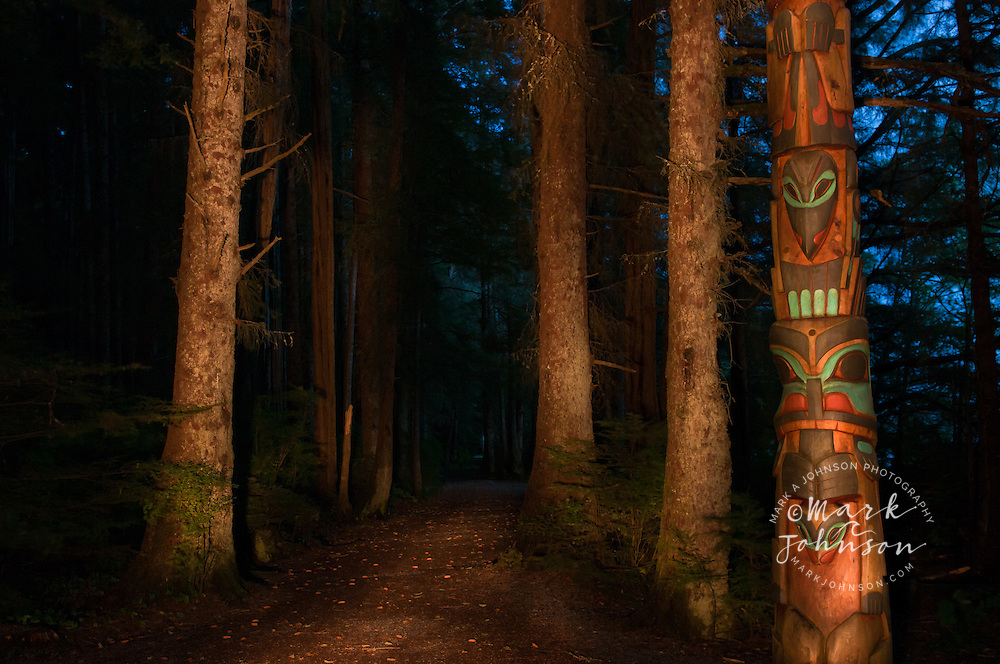 Totem pole and forest path in Sitka National Historic Park, Sitka, Alaska