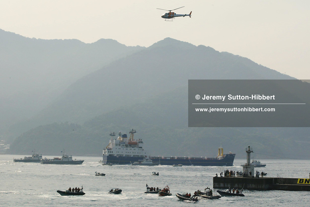 """SURROIUNDED BY JAPANESE POLICE AND COAST GUARD GREENPEACE INFLATABLES """"PROTEST"""" ( bear witness...) IN UCHIURA BAY, BESIDE THE TAKAHAMA NUCEAR PLANT, AS BNFL SHIP 'PACIFIC PINTAIL' DEPARTS LATE AFTERNOON AFTER COLLECTING REJECTED PLUTONIUM MOX FUEL, FOR SHIPMENT BACK TO THE UNITED KINGDOM. TAKAHAMA, JAPAN. 04/07/02. .PIC © JEREMY SUTTON-HIBBERT/GREENPEACE 2002..*****ALL RIGHTS RESERVED. RIGHTS FOR ONWARD TRANSMISSION OF ANY IMAGE OR FILE IS NOT GRANTED OR IMPLIED. CHANGING COPYRIGHT INFORMATION IS ILLEGAL AS SPECIFIED IN THE COPYRIGHT, DESIGN AND PATENTS ACT 1988. THE ARTIST HAS ASSERTED HIS MORAL RIGHTS. *******"""