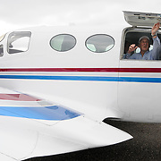 Jim Shotwell, a pilot with Aurora Aviation, prepares to take off for a flight from Aurora State Airport on Friday.