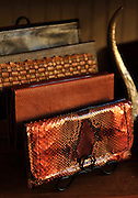 Satchel owner and designer Elizabeth Seeger creates custom leather and python clutches and bags at her business in historic downtown Savannah. (Photo by Stephen Morton)