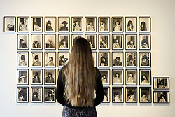 """© Licensed to London News Pictures. 25/04/2017. London, UK. A staff member views """"Verwandlungen (Transformations)"""", 1969, 2013, by Renate Bertlmann.  Launch of a new exhibition program at Sotheby's S