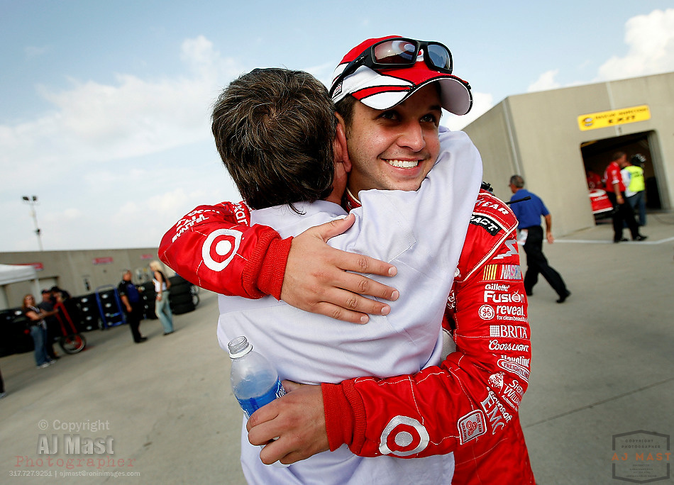 NASCAR driver Reed Sorenson is hugged by Target Chip Ganassi Racing Team manager Tony Glover after winning the pole position for the Allstate 400 at the Brickyard auto race at the Indianapolis Motor Speedway in Indianapolis, Saturday, July 28, 2007. Sorenson's qualifying speed for Sunday's race was 184.207 mph. (AP Photo/AJ Mast)