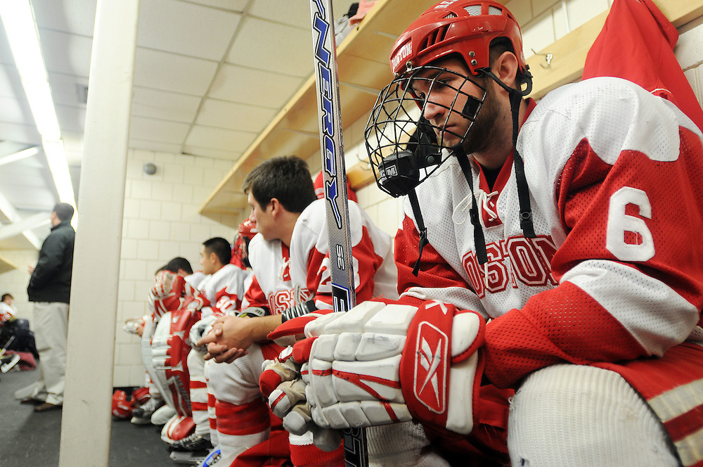 Co-Captain Andrew Edmonds (6) of Boston University's unofficial club hockey team, the Boston Red Dogs, sits in the locker room before the third period of the first round in the club hockey Beanpot at Harvard's Bright Hockey Center in Allston. The Red Dogs were the only members of four teams in the tournament unable to show affiliation with their school, because of a BU rule that states a club team cannot exist for a sport that already has a varsity team. ..Photo by Casey Germann
