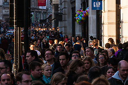 th 2014. Tens of thousands of shoppers flood central London as  Black Friday discounts and most people's pay days kick off the Christmas shopping season in earnest. PICTURED:Shafts of sunlight shining down on shoppers on Regent Street.