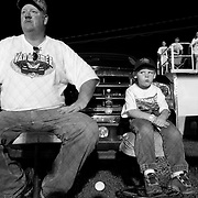 Scott Morgan/The Hawk Eye.Mark Kemper and his son Austen Kemper, 4, of Wapello watch the races..Saturday Aug. 26, 2006 at the 34 Raceway in Middletown, Iowa.