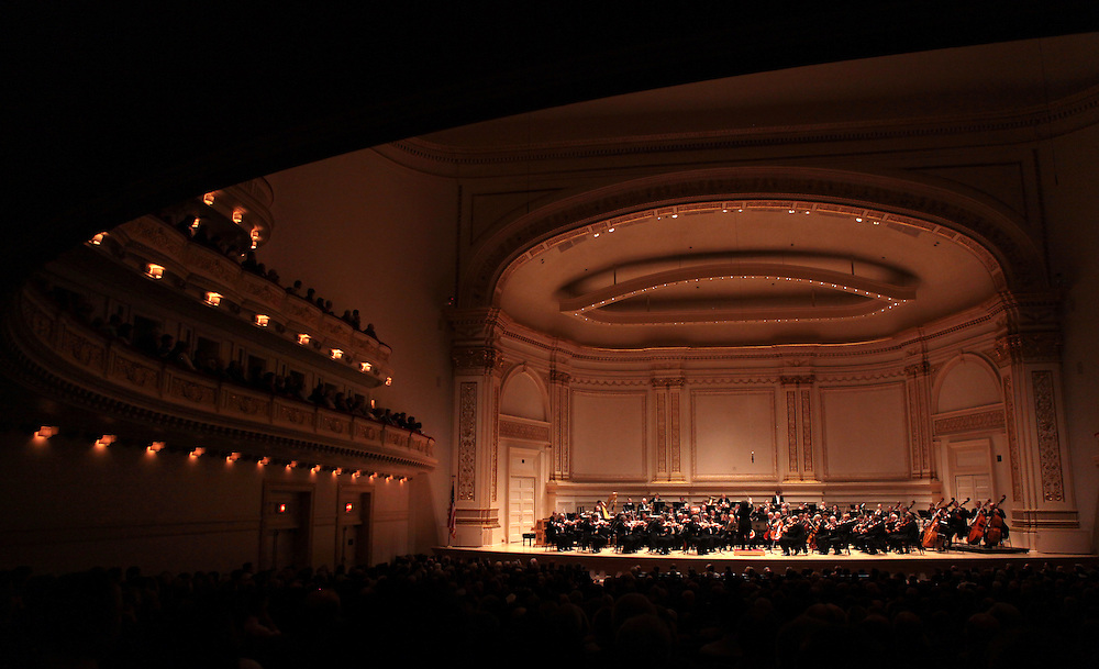 Internationally acclaimed conductor Gustavo Dudamel, right, with the Vienna Philharmonic Orchestra performing at the Isaac Stern Auditorium at Carnegie Hall in New York, NY on October 2, 2010.
