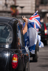 """Royal Courts of Justice, London,  August 31st 2014. Taxi drivers show their colours as as thousands of Jews and their supporters from London and across the UK demand """"Zero Tolerance for Antisemites"""", organised by the Campaign Against Antisemitism."""