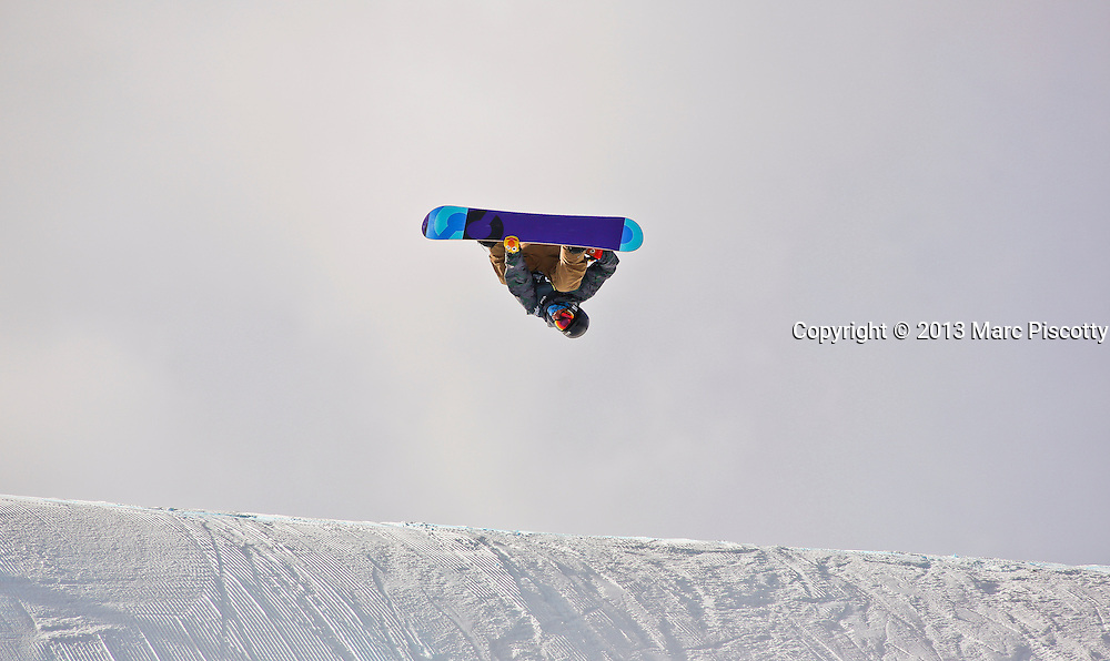 SHOT 12/19/13 12:17:28 PM - Swedish snowboarder Codey Ellison gets inverted over a jump while competing in the Men's Snowboard Slopestyle Qualifiers at the U.S. Snowboarding and Freeskiing Grand Prix on December 19, 2013 at Copper Mountain, Colorado.<br /> (Photo by Marc Piscotty / &copy; 2013)