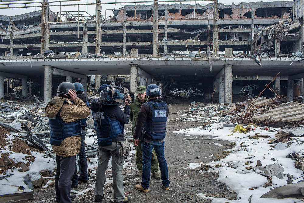Eduard Basurin, the deputy defense minister of the Donetsk People's Republic, speaks to reporters from Russia 24, a Russian television station, at the ruins of the Donetsk Airport on Tuesday, March 22, 2016 in Donetsk, Ukraine.