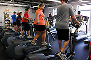 """Guests workout in the gym including (C) Heather Murray pointing to her hip during a """"mountain"""" class at the Biggest Loser Resort in Ivins, Utah September 6, 2010.  Guests at the resort affiliated with the popular reality television show typically stay for 3 to 4 weeks but Heather originally from Canada, planned to stay for 10 weeks at about $2,000 per week. REUTERS/Rick Wilking (UNITED STATES)"""