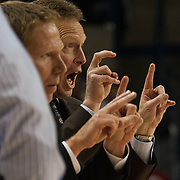 Mark Few and Ray Giacoletti call plays from the bench.