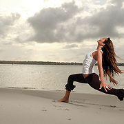 Yoga instructor Tara Folton on the beach.