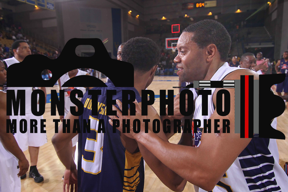Rick Deadwyler (45) celebrates with Diggy Simmons (3) after the conclusion of The 2015 Duffy's Hope Celebrity Basketball Game Saturday, August 01, 2015, at The Bob Carpenter Sports Convocation Center, in Newark, DEL.    <br /> <br /> Proceeds will benefit The Non-Profit Organization Duffy's Hope Youth Programming.