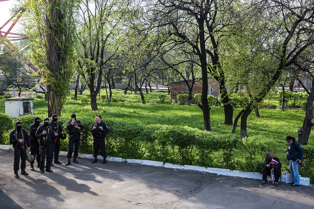 DONETSK, UKRAINE - APRIL 27: Police stand by watching a celebratory rally at TRK Donbass television station after it was taken over by pro-Russian activists on April 27, 2014 in Donetsk, Ukraine. Pro-Russian activists have been occupying government buildings and demanding greater autonomy in at least ten Eastern Ukrainian cities in recent weeks, prompting the government in Kiev to threaten military action to retake control of the cities. (Photo by Brendan Hoffman/Getty Images) *** Local Caption ***