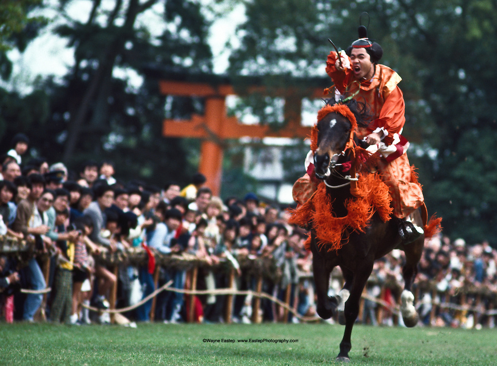 """Aoi Matsuri, or """"Holyhock Festival"""" also known as the Kamo Festival. It is a festival of the Kamo shrines in the north of the city, Shimogamo Shrine and Kamigamo Shrine. The festival originated during the reign of Emperor Kinmei (reigned CE 539-571).  The galloping horse performance is an equestrian archery performance as an annual ritual."""