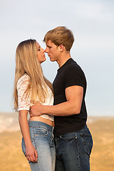 hot man and girl together outdoors