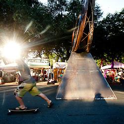 """Skateboarding past Pierre Riche's """"Healing Eye""""."""