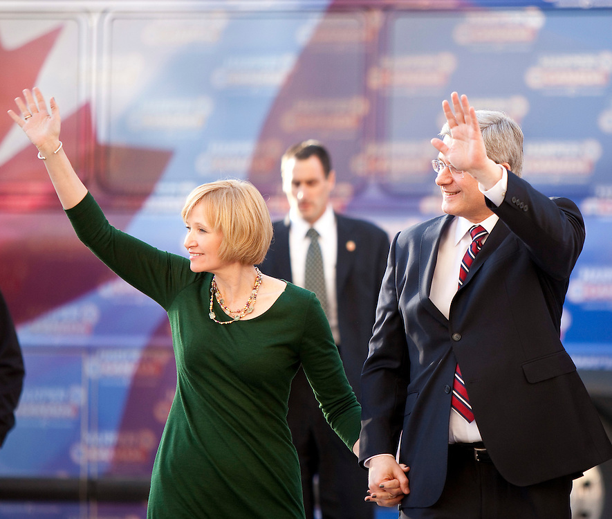 Conservative leader Stephen Harper, and his wife Laureen wave as they arrive for the english language debate in Ottawa, Ontario April 12, 2011.<br /> AFP/GEOFF ROBINS/STR