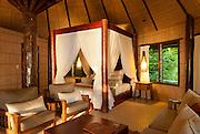 Interior of bure guest room at Matangi Private Island Resort, Fiji.