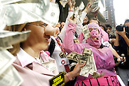 Protestors wearing pig snouts, costumes and a Dick Cheney mask demonstrate in front of the Hilton Hotel in  August 31, 2004 in New York City. Halliburton was hosting a breakfast inside the hotel for the Texas delegates to the Republican National Convention.