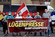 Frankfurt am Main   21 Apr 2015<br /> <br /> Am Dienstag (21.04.2015) hielt die rassistische und islamfeindliche Gruppe PEGIDA (Patriotische Europ&auml;er gegen die Islamisierung des Abendlandes) an der Hauotwache neben der Katharinenkirche in Frankfurt am Main eine Mahnwache unter dem Motto &quot;Wir sind wieder da&quot; ab. Die Kundgebung war wie immer mit Hamburger Gittern abgesperrt und von starken Polizeikr&auml;ften bewacht. Etwa 1000 Menschen nahmen an den Gegenprotesten teil.<br /> Hier: Bei der PEGIDA-Kundgebung haben sich die hessischen NPD-Aktivisten Stefan Jagsch (m) und Daniel Lachmann (r) hinter einem Transparent mit der Aufschrift &quot;Und wenn sie auch geifern... L&uuml;genpresse bleibt L&uuml;genpresse&quot; aufgestellt.<br /> <br /> &copy;peter-juelich.com<br /> <br /> [Foto Honorarpflichtig   No Model Release   No Property Release]