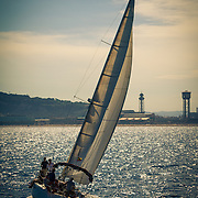 Spain, Barcelona. Sailboat catching the wind on the Balearic Sea just off the coast.