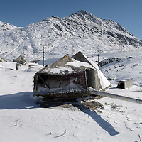Remains of military installations no longer in use, close to the top of the Gotthard Pass (2106m)  in the Alps. The gun, one of several above a large bunker, has its head disguised as a rock.