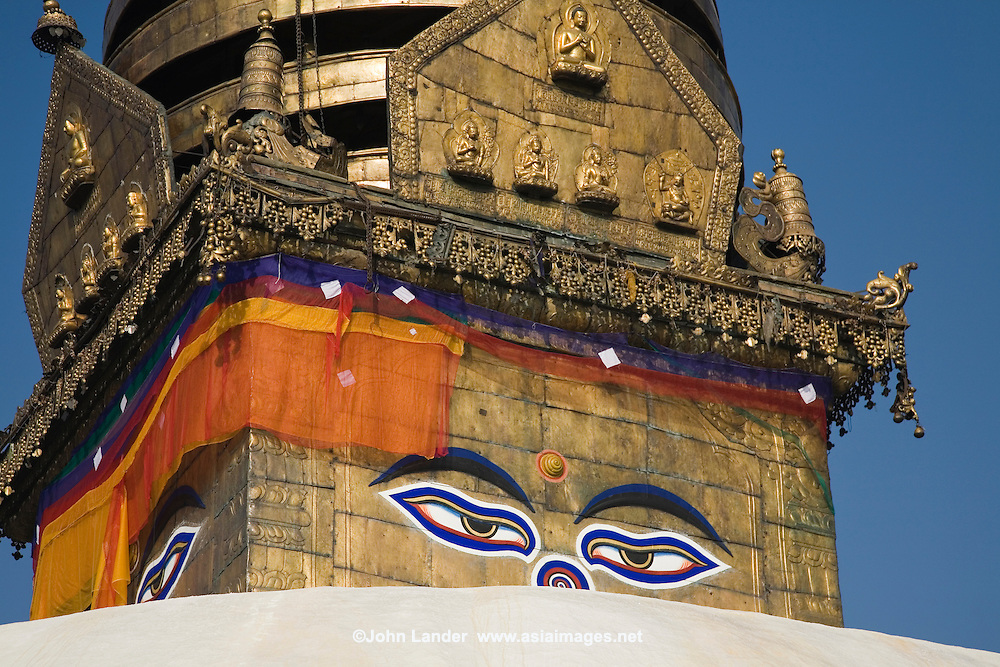 """Third Eye at Swayambhunath Temple - Swayambhunath Temple is one of the liveliest Buddhist temples in Kathmandu if not all of Nepal. Many Tibetans live in the area, and make their daily 'kora' or procession around the temple, turning prayer wheels as they pass. Swayambhunath is also known affectionately as """"Monkey Temple"""" for the hundreds of monkeys who inhabit the area and playfully jump around the Buddha, stairways and temple buildings."""