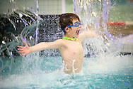 Griffin Miller, 8, plays in the waterfall recently at the Teton County Recreation Center. Family swim times are from 4:00 p.m. to 8:00 p.m. Monday through Thursday and from 1:00 p.m. to 8:00 p.m. on Saturday.