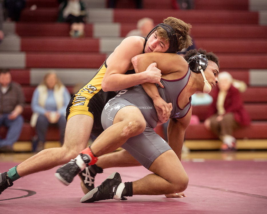 Lisa Johnston | lisajohnston@archstl.org | @aeternusphot Vianney's Joseph Nelson made a move on DeSmet's Tyrell Mosley in the 145lb match that resulted in Nelson's win .DeSmet Jesuit High School Spartans won their wrestling match 39-26 over St. John Vianney's Griffins. This was the first time in five years they have seen victory over their rival.