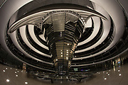 This is the interior of the dome on the Reichstag building in Berlin. At the center of the mirrored column, it is possible to look down into the government floor.
