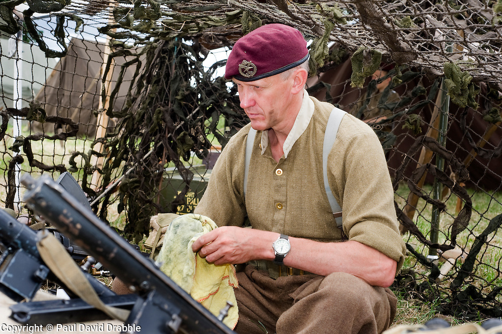 A re-enactor from the Northern World War Two Association Living History group portraying a British Paratrooper from the 22nd Indepenant Company, 6th Airborne Parachute Regiment chats to members of the public from a living history dispaly. SPAM 1940's Weekend. Heckmonwyke near Wakefield 10 July 2010 .Images © Paul David Drabble