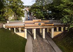 Old wooden Inglisild, Angel`s Bridge in Tartu, Estonia.  Cobblestone pavement, sidewalk