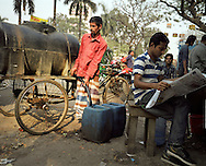 Mohamed Bulbul, 40, sells water to local shop owners in downtown Dhaka for  Tk12/gallon. He make Tk300/day selling water which he claims come from a WASA (Water Supply & Sewerage Authority) water point.