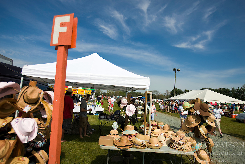 A hat vendor sells their wares outside row orange F at the Foxfield Races.  The 2009 Foxfield Races were held at the Foxfield Race Course in Charlottesville, VA on April 25, 2009. (Special to the Daily Progress / Jason O. Watson)