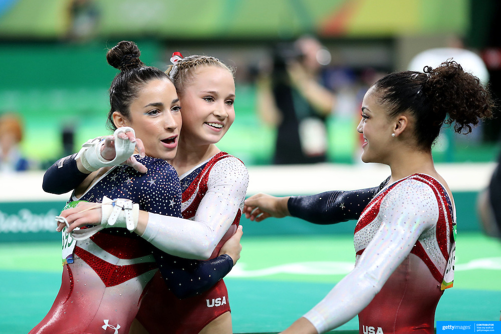 Gymnastics - Olympics: Day 4   Madison Kocian of the United States is congratulated by team mates Alexandra Raisman, (left) and Lauren Hernandez after performing her routine on the Horizontal bar during the Artistic Gymnastics Women's Team Final at the Rio Olympic Arena on August 9, 2016 in Rio de Janeiro, Brazil. (Photo by Tim Clayton/Corbis via Getty Images)